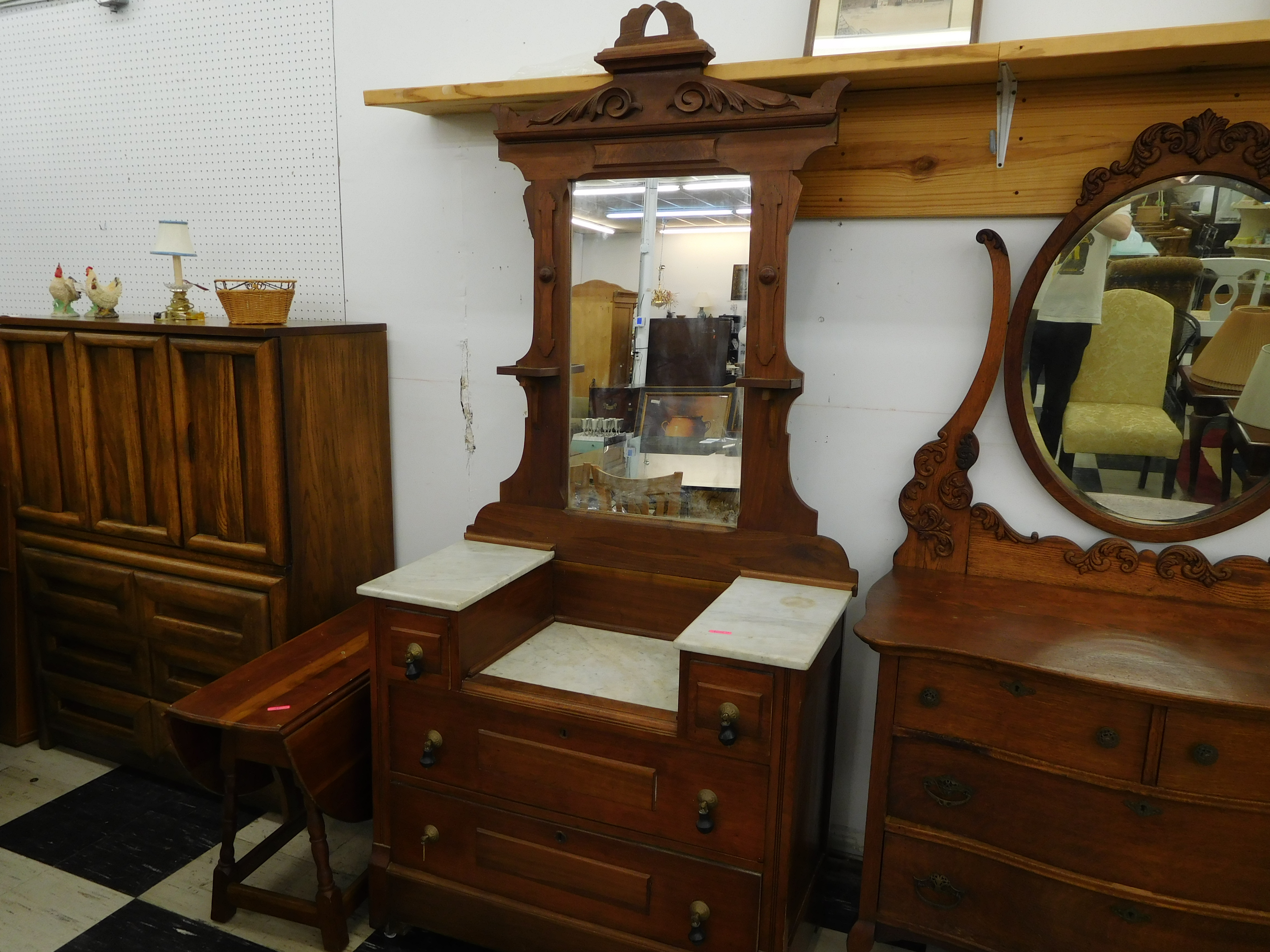 Magnificent Marble Top Vanity with Ornately Carved Mirror Frame