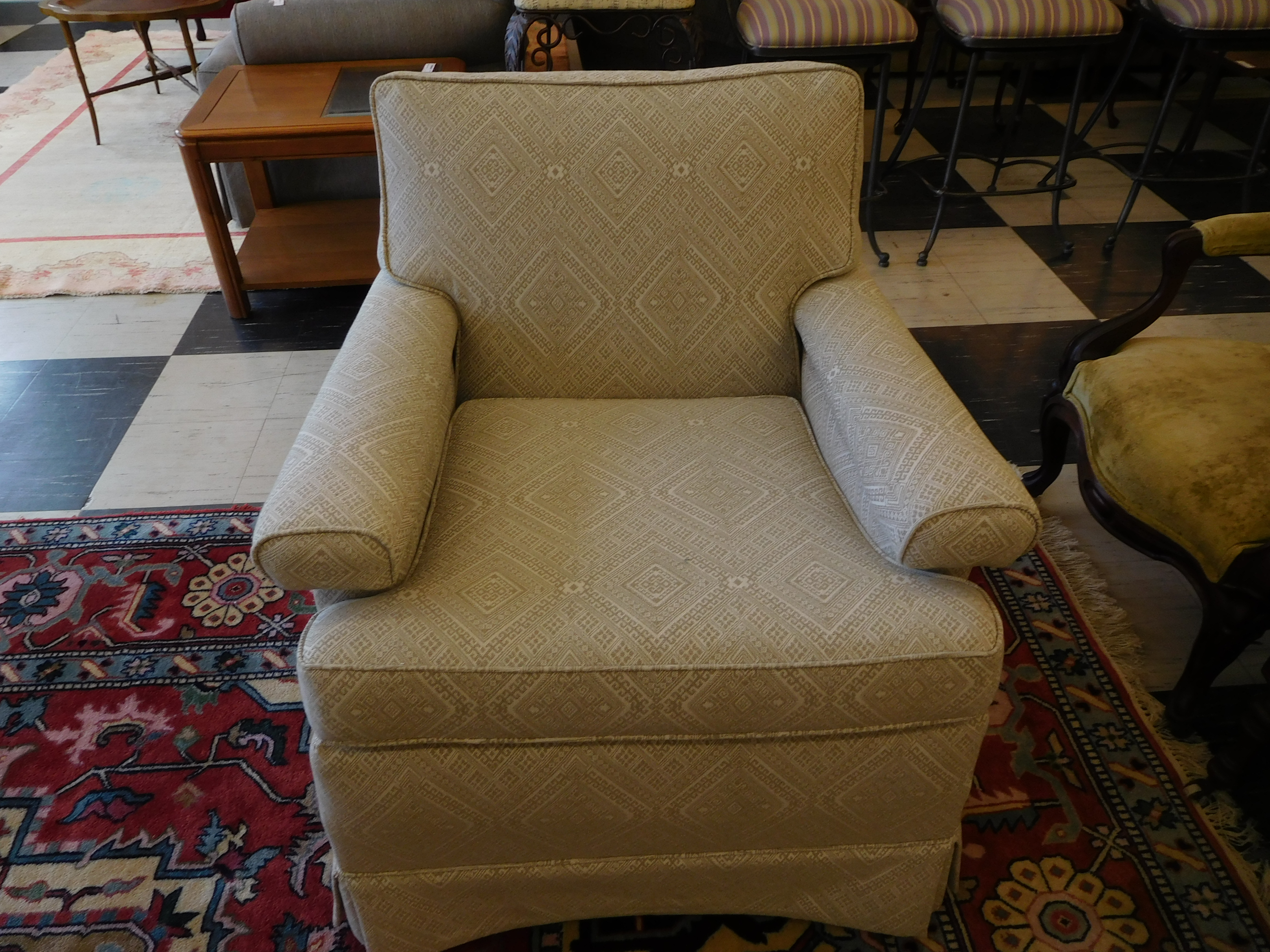 Cream-Colored Lounge Chair with Subtle Upholstery Pattern