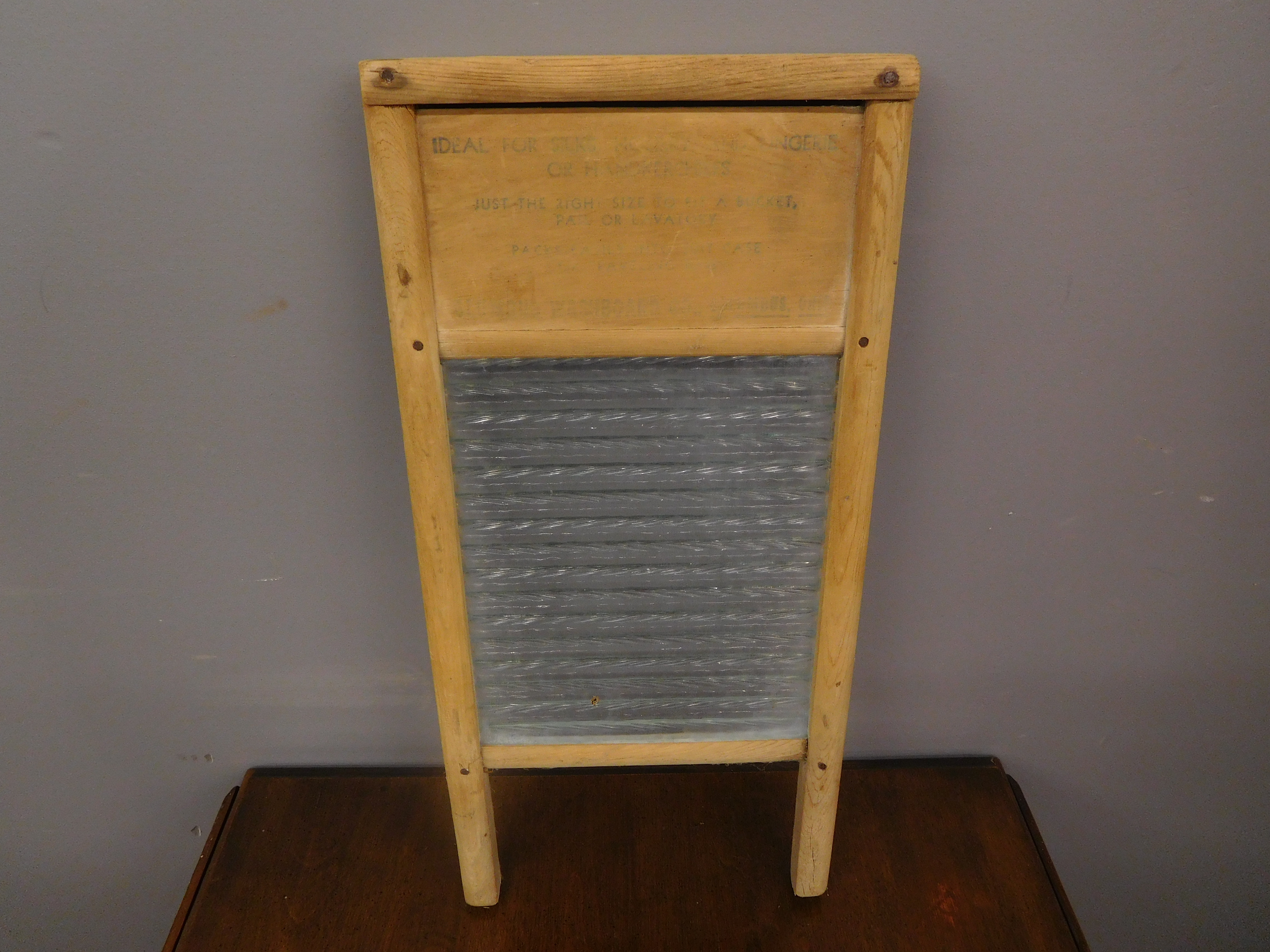 Small Vintage Washboard with Faded Words . . .