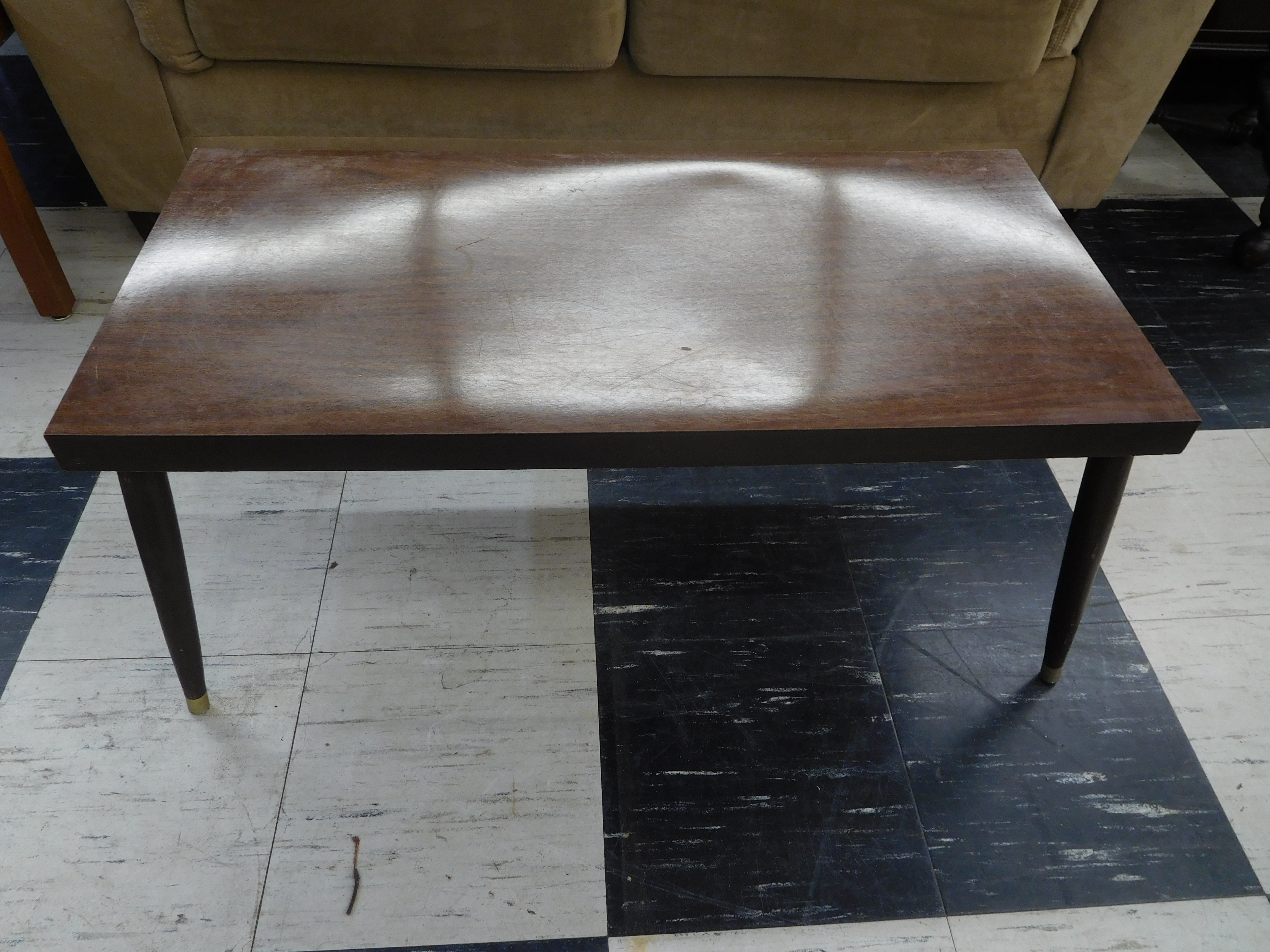 Mid Century Coffee Table with Tapered Round Legs and Brass