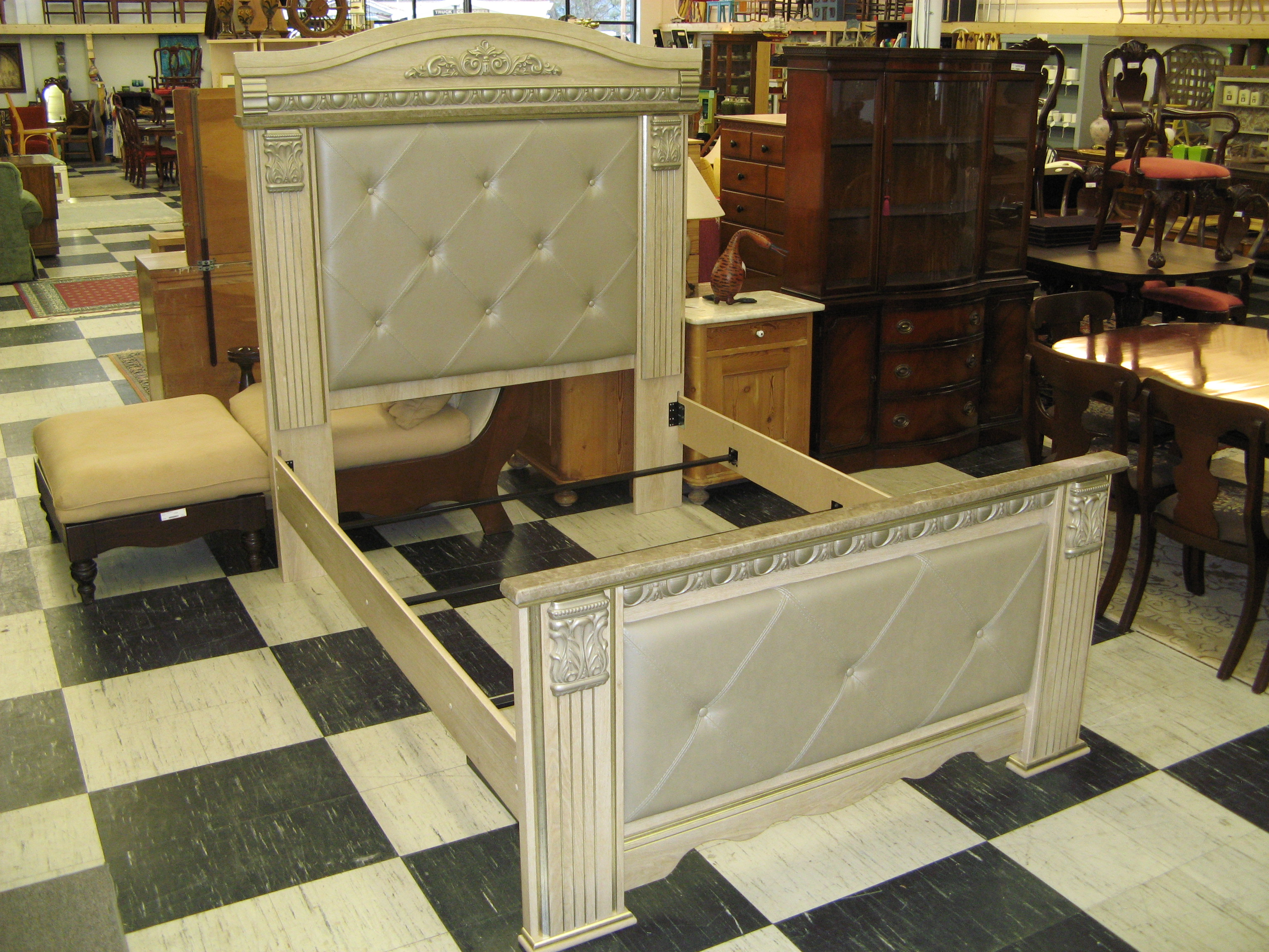 Queen Size Bed with Carved Detail by Ashley Furniture