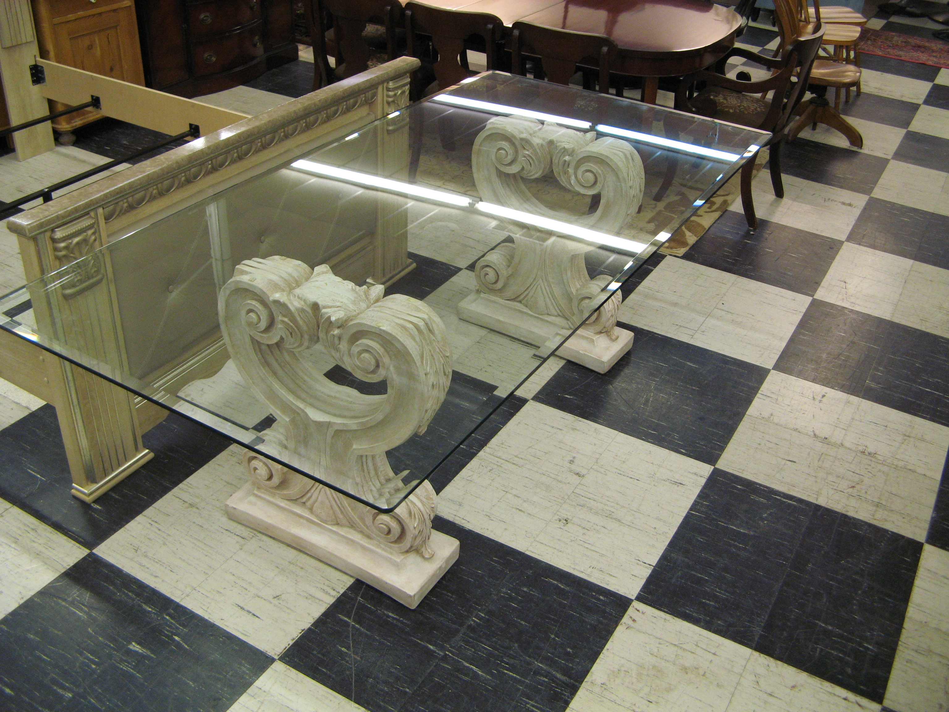Contemporary Glass Top Dining Table with Carved Stone Pedestals