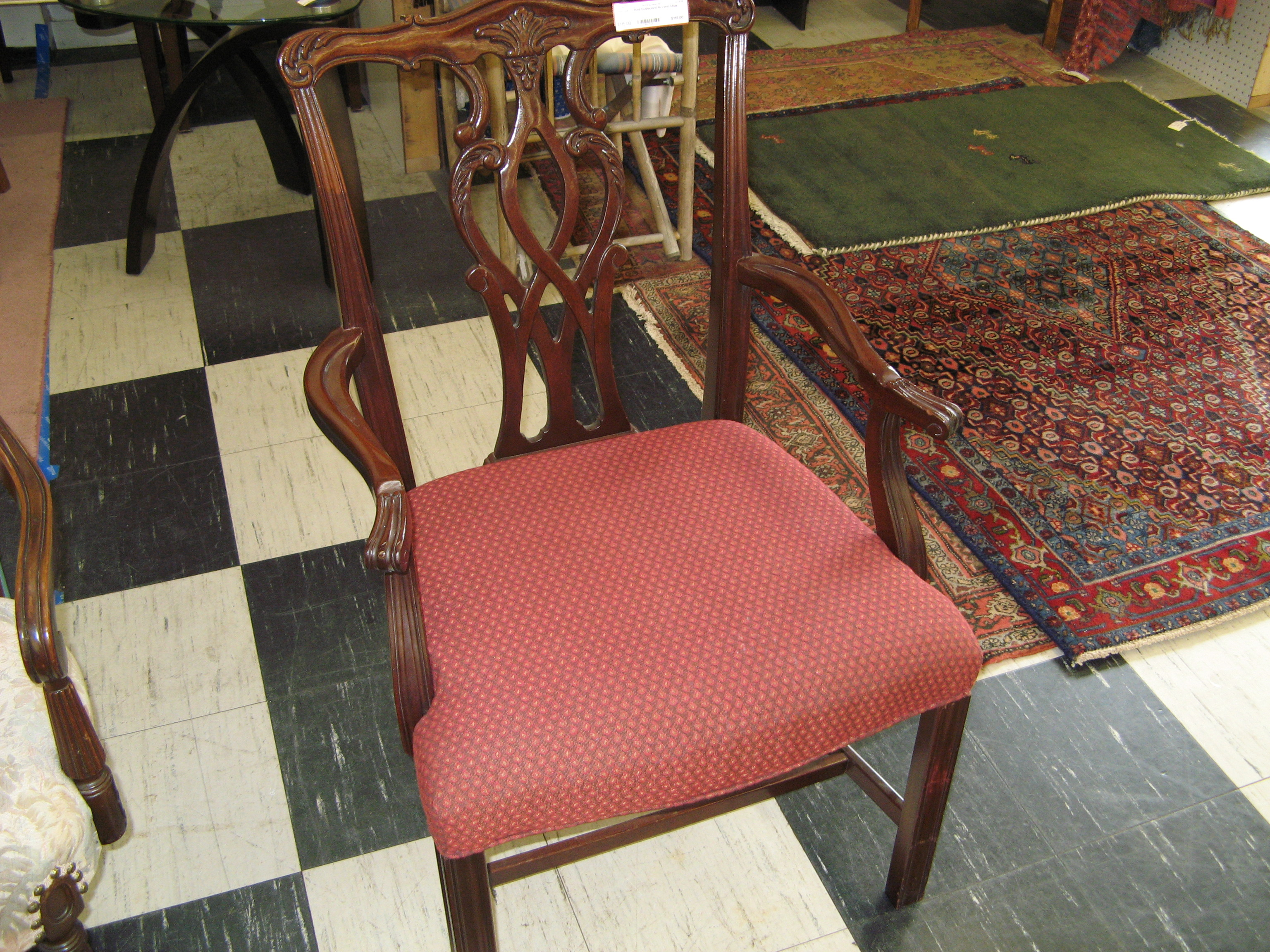 Red Cushioned Accent Chair with Ornately Carved Back