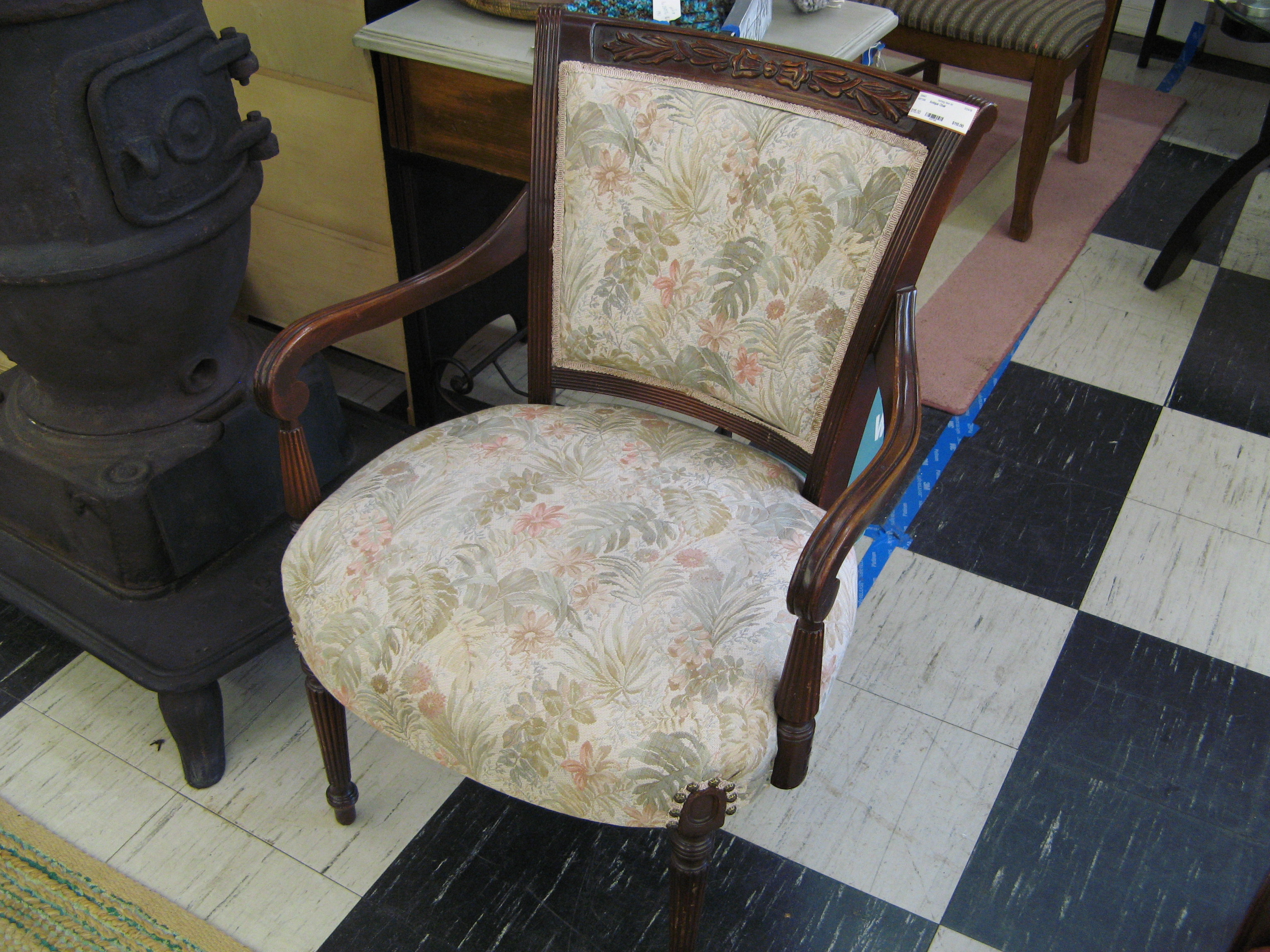 Antique Chair with Soft Floral Upholstery