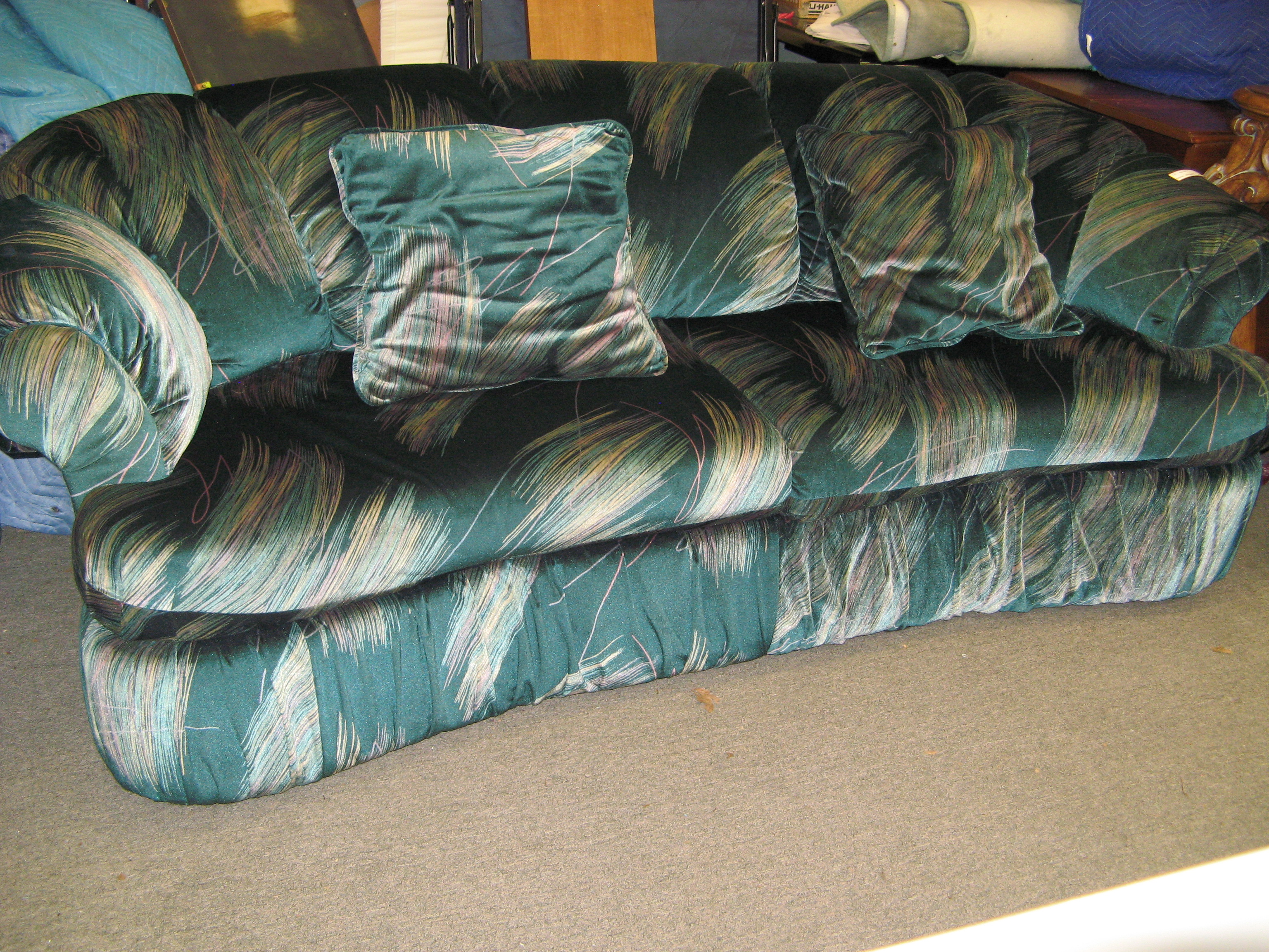 Green Teal Sofa with Abstract Bands of Color